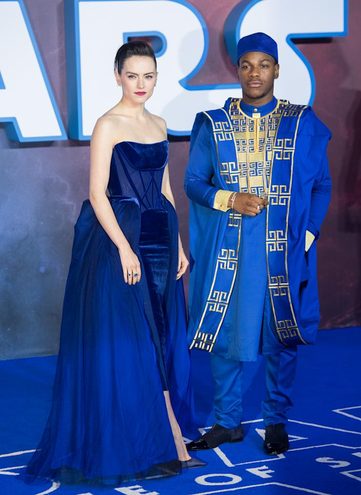 John Boyega, wearing traditional dress, and Daisy Ridley, in Vivienne Westwood Couture, at the 'Star Wars: The Rise of Skywalker' London premiere [Photo: Getty]