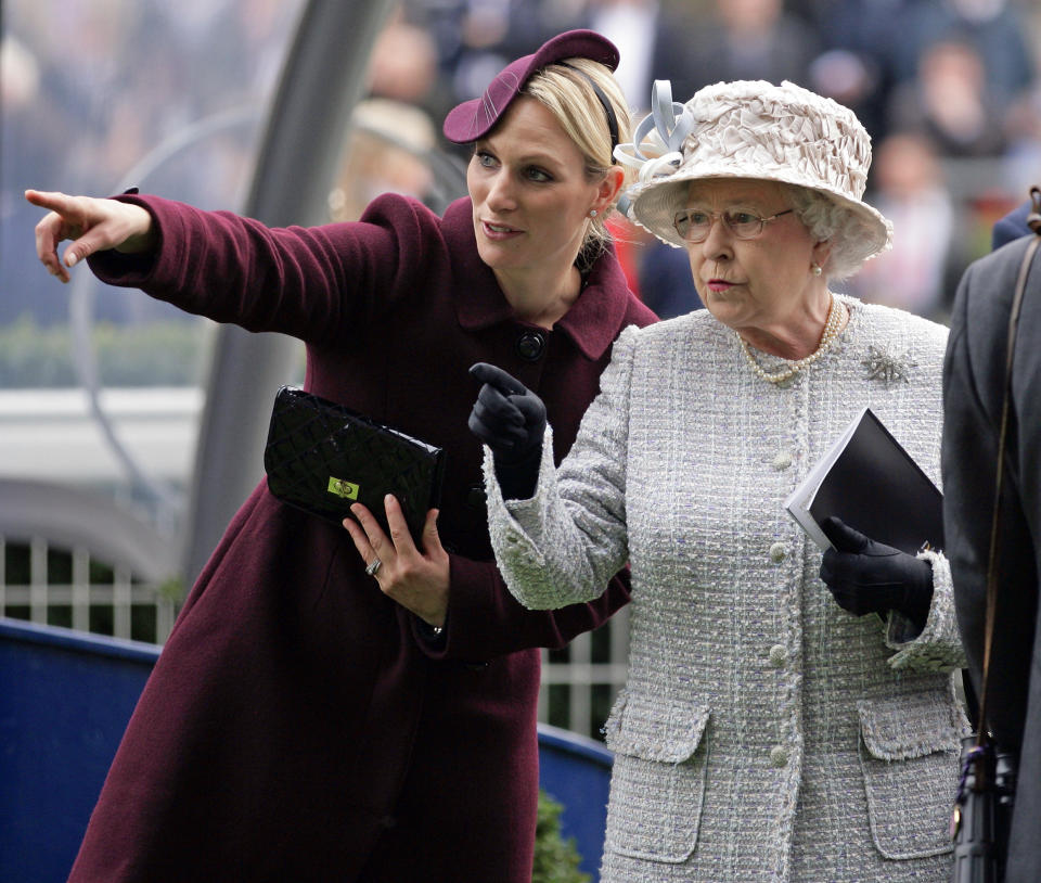 Zara Phillips points out something to the Queen at the QIPCO British Champions Day meet at Ascot Racecourse on October 20, 2012 in Ascot, England.
