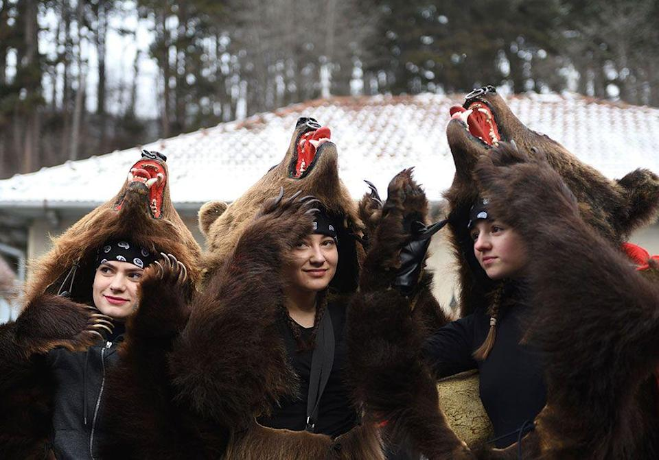 <p>Animal lovers, skip this slide. Romanians in the Moldova region have an annual festival between Christmas and New Year's where they dance around wearing real bearskins. The dancing is supposed to scare away any bad energy that might follow them into the next year. </p>
