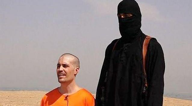 The video shows a prisoner in orange being forced to kneel and recite a message to the United States of America. Photo: Twitter.