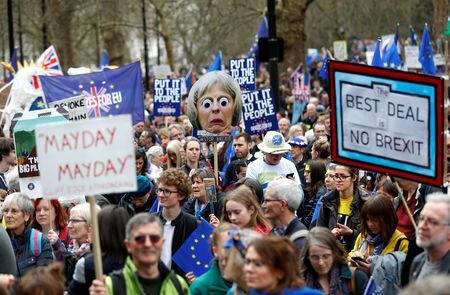 EU supporters, calling on the government to give Britons a vote on the final Brexit deal, participate in the 'People's Vote' march in central London, Britain March 23, 2019. REUTERS/Peter Nicholls