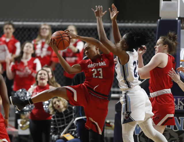 Hartford's Alexia Douglas pulls down a rebound against Maine's Tanesha Sutton in the first half in the America East Conference women's basketball championship, Friday, March 9, 2018, in Bangor, Maine. (AP Photo/Robert F. Bukaty)