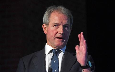 Owen Paterson, pictured, insist comments made in recent days about the need to review the Good Friday Agreement relate to the year-long suspension of power-sharing in Stormont, and not Brexit - Credit: Victoria Jones/PA
