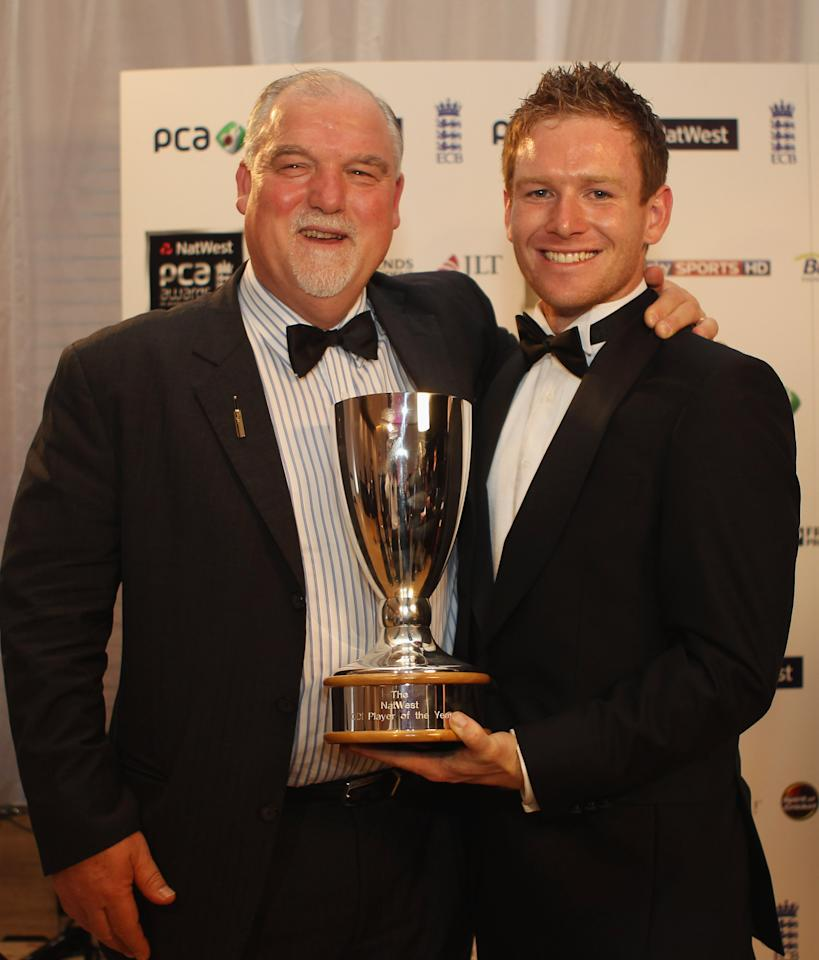 LONDON, ENGLAND - SEPTEMBER 23:  Eoin Morgan (R) with the NatWest ODI Player of the Year award and Mike Gatting pose together during PCA Awards dinner at the Hurlingham Club on September 23, 2010 in London, England.  (Photo by Tom Shaw/Getty Images)
