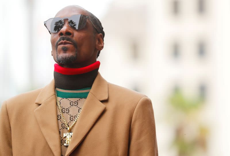 """FILE PHOTO: Rapper Snoop Dogg receives his star on the """"Hollywood Walk of Fame"""" in Los Angeles"""