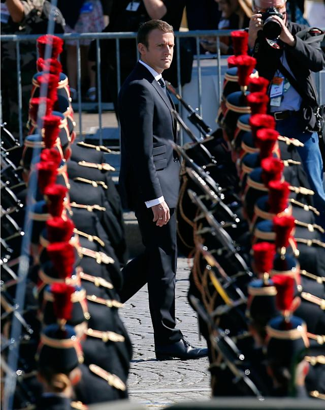 <p>French President Emmanuel Macron reviews an honor guard prior to the traditional Bastille Day military parade on the Champs Elysees, in Paris, Friday, July 14, 2017. (Photo: Kamil Zihnioglu/AP) </p>