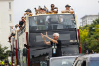 Wisconsin Governor Tony Evers takes part in a parade during a celebration for the NBA Championship Milwaukee Bucks basketball team Thursday, July 22, 2021, in Milwaukee. (AP Photo/Jeffrey Phelps)