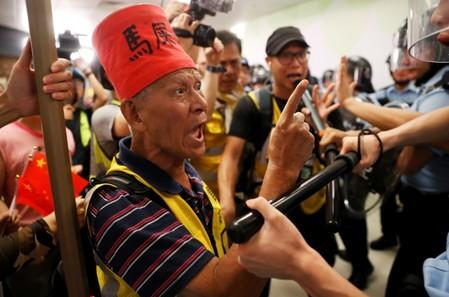 A protester shouts at the police officers at Amoy Plaza shopping mall in Kowloon Bay, Hong Kong