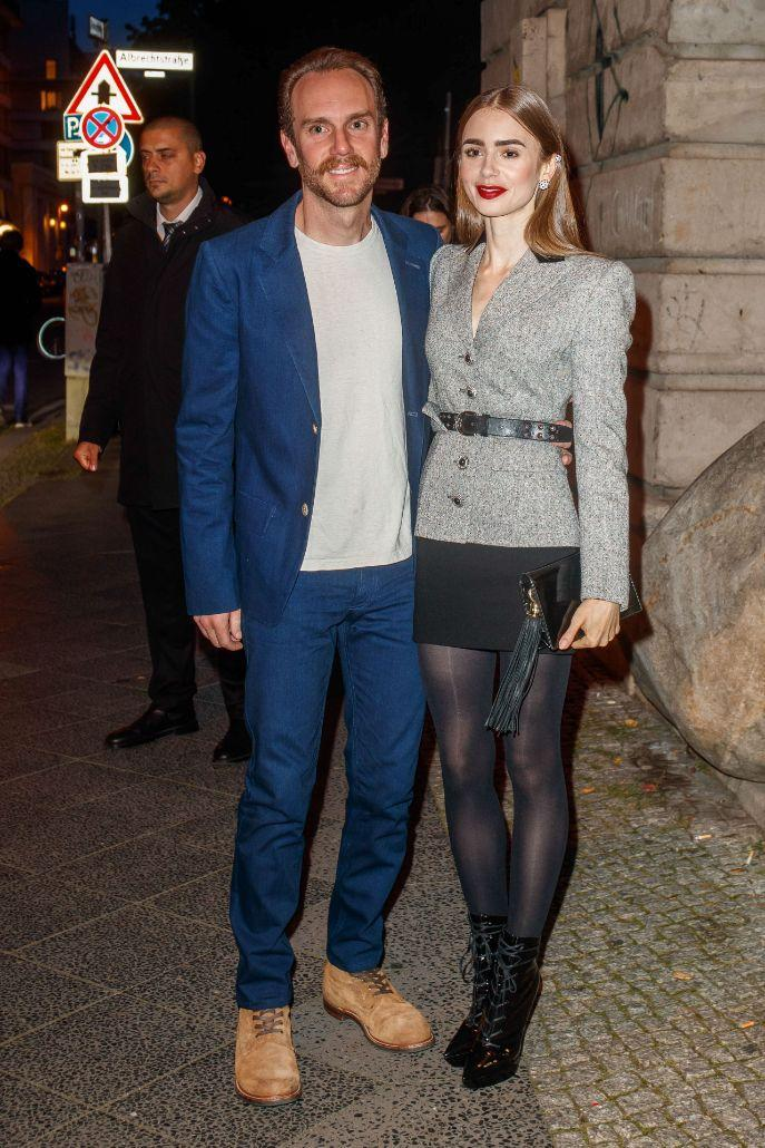 Lily Collins and Charlie McDowell outside of her Clash de Cartier Even in Berlin, Sept. 21. - Credit: People Picture/Splash News