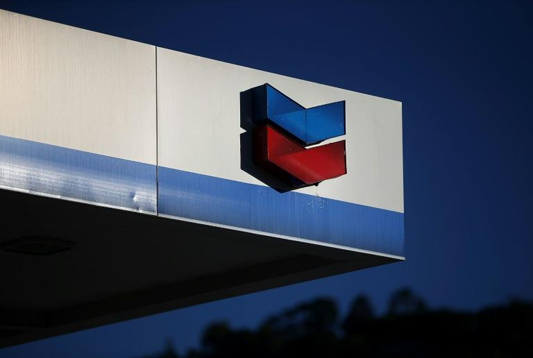 Chevron announced it will slash the value of its assets by $10 to $11 billion due to weaker oil and natural gas prices that prompted the company to consider abandoning some projects
