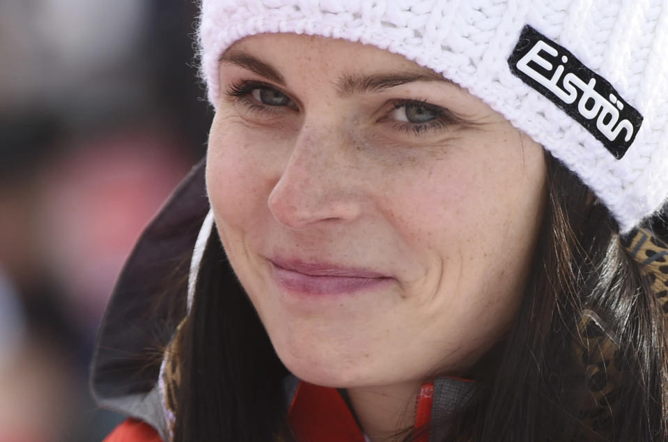 FILE - In this Dec. 17, 2017, file photo, Austria's Anna Veith smiles in the finish area at the women's World Cup super-G ski race in Val d'Isere, France. Veith, who twice returned to the top from serious knee injuries but called it a career a year after blowing out her knee for the third time, announced her retirement Saturday, May 23, 2020. (AP Photo/Marco Tacca, File)