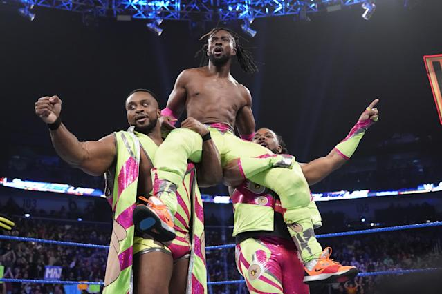 "Big E and Xavier Woods celebrate with Kofi Kingston during an episode of ""Smackdown Live."" (WWE)"