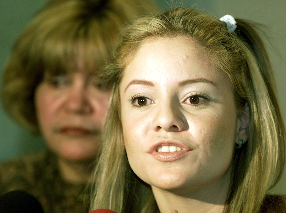 A former member of fallen Mexican pop star Gloria Trevi's group, Karina Yapor (R) speaks while her mother Maria Teresita watches behind during a press conference in the Mexican northern city of Chihuahua, December 21, 2002. Yapor accuses Trevi of rape, kidnapping and corruption. Trevi, a former pop singer, was extradited from Brazil to face those legal charges against her. [Trevi and her former manager Sergio Andrade were arrested on January 13, 2000, in Rio de Janeiro.]