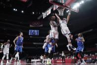 United States's Jrue Holiday (12) and Jayson Tatum (10) leap for a rebound during a men's basketball preliminary round game against the Czech Republic at the 2020 Summer Olympics, Saturday, July 31, 2021, in Saitama, Japan. (AP Photo/Eric Gay)