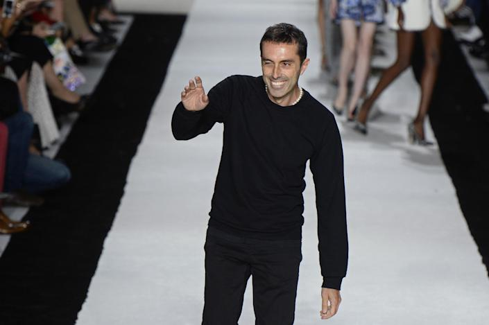 Italian fashion designer Giambattista Valli acknowledges the audience at the end of his 2015 spring/summer ready-to-wear collection fashion show, on September 29, 2014 in Paris (AFP Photo/Bertrand Guay)