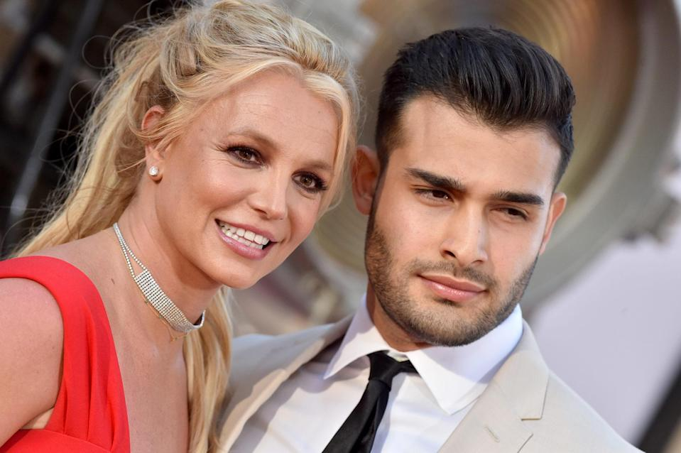 Close crop of Britney Spears and her boyfriend Sam Asghari smiling on the red carpet