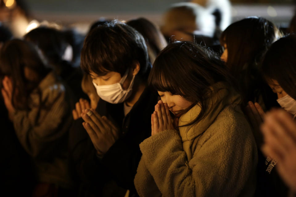 People offer their new year's prayers at the Meiji Jingu Shinto shrine as they celebrate the arrival of the year 2020, Wednesday, Jan 1, 2020, in Tokyo. (AP Photo/Kiichiro Sato)