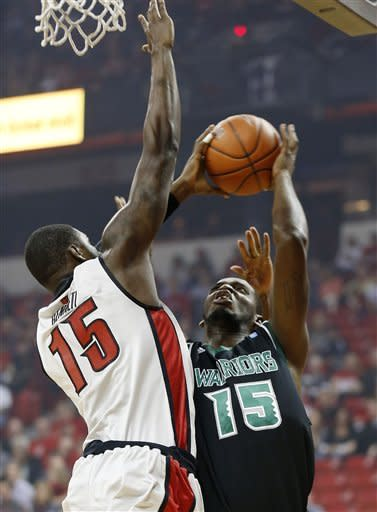 Hawaii's Vander Joaquim shoots covered by UNLV's Anthony Bennett, of Canada, during the first half of an NCAA college basketball game on Saturday, Dec. 1, 2012, in Las Vegas. (AP Photo/Isaac Brekken)
