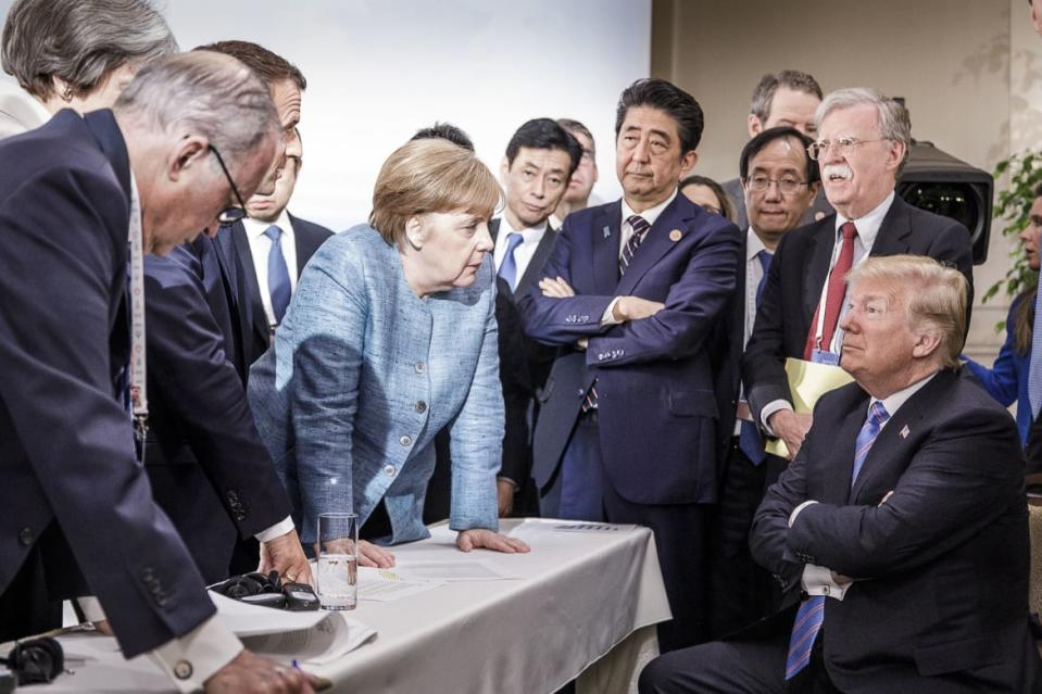 "<div class=""inline-image__caption""><p>In this photo provided by the German Government Press Office (BPA), German Chancellor Angela Merkel deliberates with US president Donald Trump on the sidelines of the official agenda on the second day of the G7 summit on June 9, 2018 in Charlevoix, Canada. Also pictured are (L-R) Larry Kudlow, director of the US National Economic Council, Theresa May, UK prime minister, Emmanuel Macron, French president, Angela Merkel, Yasutoshi Nishimura, Japanese deputy chief cabinet secretary, Shinzo Abe, Japan prime minister, Kazuyuki Yamazaki, Japanese senior deputy minister for foreign affairs, John Bolton, US national security adviser, and Donald Trump. Canada are hosting the leaders of the UK, Italy, the US, France, Germany and Japan for the two day summit. </p></div> <div class=""inline-image__credit"">Jesco Denzel /Bundesregierung via Getty</div>"