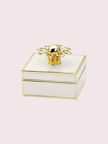 """<p><strong>kate spade</strong></p><p>katespade.com</p><p><strong>$50.00</strong></p><p><a href=""""https://go.redirectingat.com?id=74968X1596630&url=https%3A%2F%2Fwww.katespade.com%2Fproducts%2Fkeaton-jewelry-box%2FL871930.html&sref=https%3A%2F%2Fwww.housebeautiful.com%2Fshopping%2Fg1969%2Fholiday-gifts-for-women%2F"""" rel=""""nofollow noopener"""" target=""""_blank"""" data-ylk=""""slk:BUY NOW"""" class=""""link rapid-noclick-resp"""">BUY NOW</a></p><p>This simple stunner is the perfect jewelry box to house all her favorite pieces, from earrings to necklaces.</p>"""