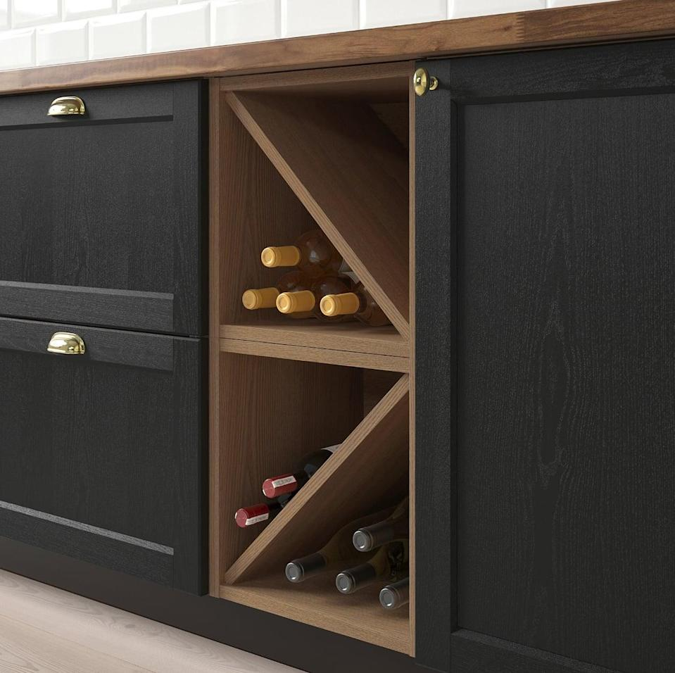 "<p>Wine-lovers will appreciate the <a href=""https://www.popsugar.com/buy/Vadholma%20Wine%20Shelf-446992?p_name=Vadholma%20Wine%20Shelf&retailer=ikea.com&price=69&evar1=casa%3Aus&evar9=46151613&evar98=https%3A%2F%2Fwww.popsugar.com%2Fhome%2Fphoto-gallery%2F46151613%2Fimage%2F46152181%2FVadholma-Wine-Shelf&list1=shopping%2Cikea%2Corganization%2Ckitchens%2Chome%20shopping&prop13=api&pdata=1"" rel=""nofollow noopener"" target=""_blank"" data-ylk=""slk:Vadholma Wine Shelf"" class=""link rapid-noclick-resp"">Vadholma Wine Shelf</a> ($69). It effortlessly fits in unused spaces and keeps bottles right where they belong.</p>"