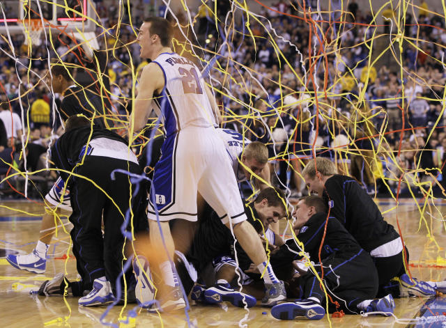 FILE - In this April 5, 2010, file photo, Duke's Miles Plumlee (21) and teammates celebrate after Duke's 61-59 win over Butler in the men's NCAA Final Four college basketball championship game in Indianapolis. (AP Photo/Charlie Neibergall, File)