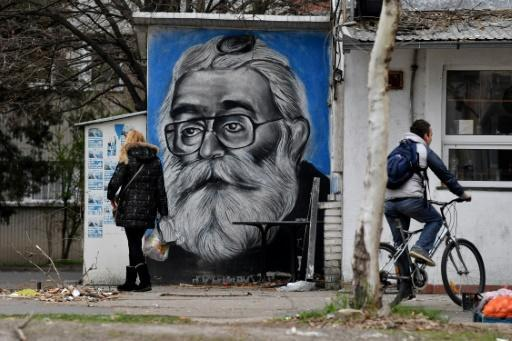 Street art on the wall of a tavern in Belgrade depicts former Bosnian Serb leader Radovan Karadzic when he was on the run, posing as a New Age healer called Dragan Dabic