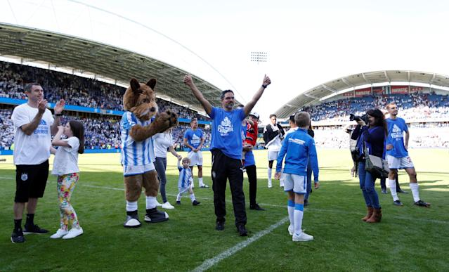 "Soccer Football - Premier League - Huddersfield Town vs Arsenal - John Smith's Stadium, Huddersfield, Britain - May 13, 2018 Huddersfield Town manager David Wagner celebrates in front of the fans at the end of the match Action Images via Reuters/Andrew Boyers EDITORIAL USE ONLY. No use with unauthorized audio, video, data, fixture lists, club/league logos or ""live"" services. Online in-match use limited to 75 images, no video emulation. No use in betting, games or single club/league/player publications. Please contact your account representative for further details."