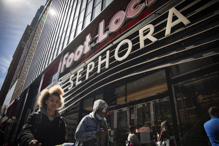People walk outside a Sephora store in New York on Friday, May 7, 2021. The beauty retailer recently announced a commitment to devote at least 15% of its store shelves to Black-owned brands. (AP Photo/Robert Bumsted)