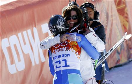 Slovenia's Maze hugs Switzerland's Gisin after they jointly won the women's alpine skiing downhill race at the 2014 Sochi Winter Olympics