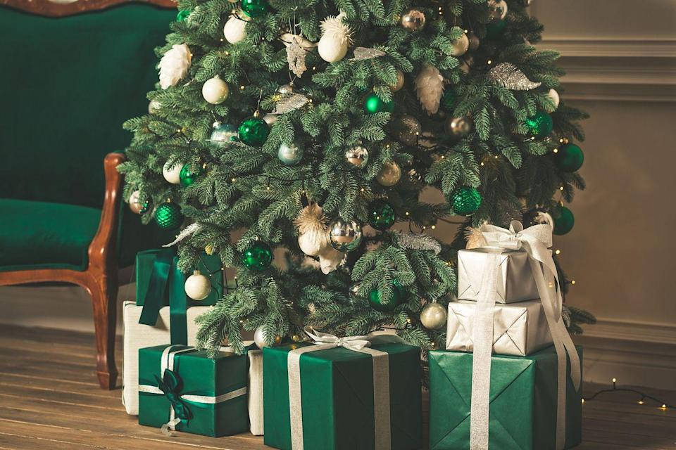 <p>Covering a green Christmas tree with various shades of the same hue makes the greenery pop even more while offering a bold, cohesive design.</p>