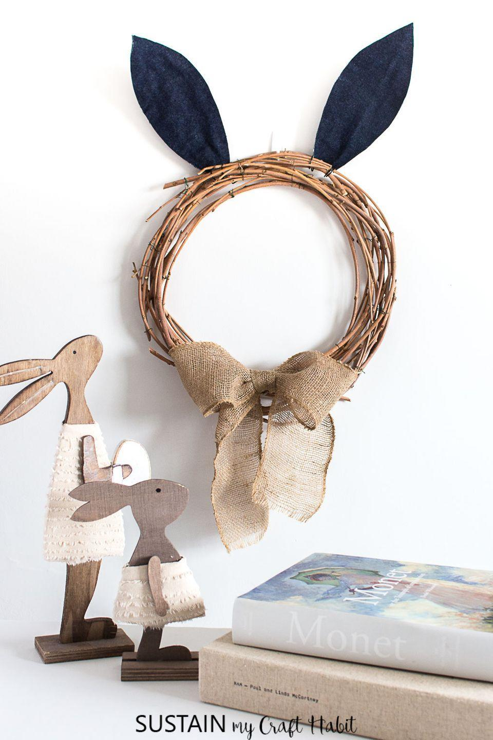 """<p>Hop to it! All this easy-peasy craft requires is a grapevine wreath form, some fabric bunny ears, and a burlap ribbon. </p><p><strong>Get the tutorial at <a href=""""https://sustainmycrafthabit.com/diy-easter-wreath/"""" rel=""""nofollow noopener"""" target=""""_blank"""" data-ylk=""""slk:Sustain My Craft Habit"""" class=""""link rapid-noclick-resp"""">Sustain My Craft Habit</a>.</strong></p><p><a class=""""link rapid-noclick-resp"""" href=""""https://go.redirectingat.com?id=74968X1596630&url=https%3A%2F%2Fwww.walmart.com%2Fip%2FSinger-8-5-Bent-Fabric-Scissors-1-Each%2F21982993&sref=https%3A%2F%2Fwww.thepioneerwoman.com%2Fhome-lifestyle%2Fcrafts-diy%2Fg35698457%2Fdiy-easter-wreath-ideas%2F"""" rel=""""nofollow noopener"""" target=""""_blank"""" data-ylk=""""slk:SHOP FABRIC SCISSORS"""">SHOP FABRIC SCISSORS</a></p>"""