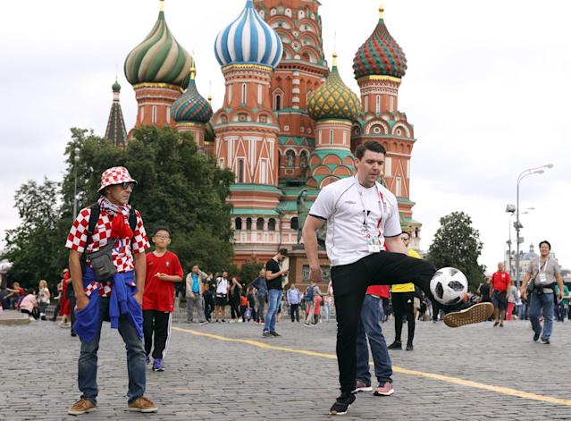 Fans mix in central Moscow hours before the match. (PA)
