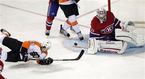 Philadelphia Flyers' Harry Zolnierczyk (29) scores on Montreal Canadiens goalie Carey Price (31) while falling to the ice during second-period NHL hockey game action on Thursday, Dec. 15, 2011, in Montreal. (AP Photo/The Canadian Press, Ryan Remiorz)
