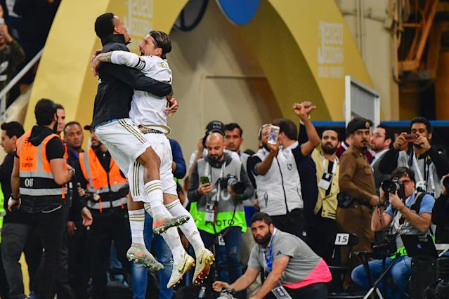 Real Madrid's Sergio Ramos (right) celebrates with teammate Eder Militao after winning the Spanish Super Cup on Sunday in Saudi Arabia. (Photo by GIUSEPPE CACACE/AFP via Getty Images)