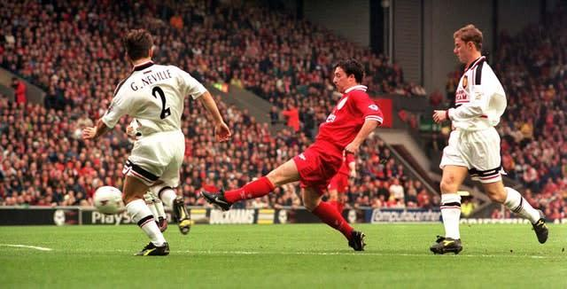 Robbie Fowler, centre, had two spells at Liverpool as a player (PA)