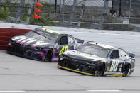 Jimmie Johnson (48) and Alex Bowman (88) come down a straightaway during the NASCAR Cup Series auto race Sunday, May 17, 2020, in Darlington, S.C. (AP Photo/Brynn Anderson)