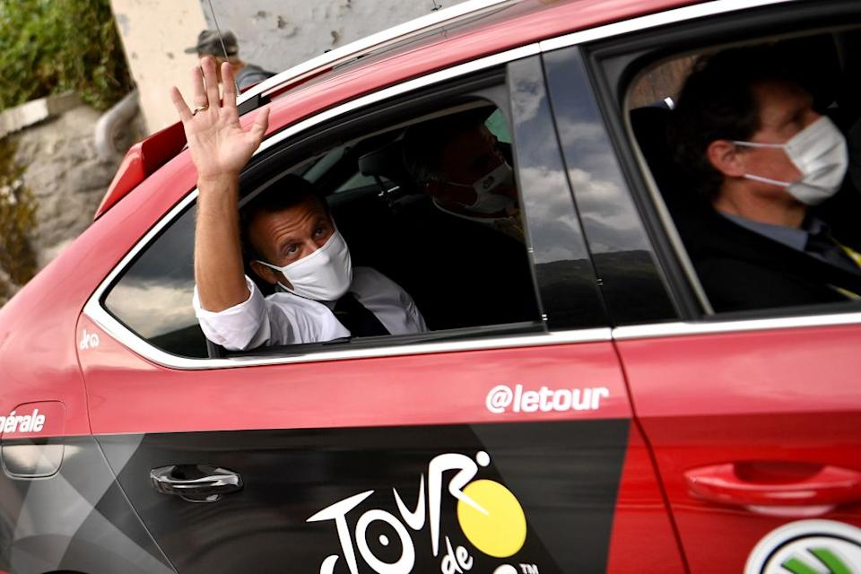 French President Emmanuel Macron L sits in a car next to former rider and current ASO sporting manager Franois Lemarchand unseen as he spends a day on the Tour de France during the 17th stage of the 107th edition of the Tour de France cycling race 170 km between Grenoble and Meribel on September 16 2020 Photo by AnneChristine POUJOULAT  AFP Photo by ANNECHRISTINE POUJOULATAFP via Getty Images