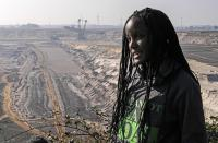 Climate activist Vanessa Nakate from Uganda gives an interview to the Associated Press during her visit to the Garzweiler open-cast coal mine in Luetzerath, western Germany, Saturday, Oct. 9, 2021. Garzweiler, operated by utility giant RWE, has become a focus of protests by people who want Germany to stop extracting and burning coal as soon as possible. (AP Photo/Martin Meissner)