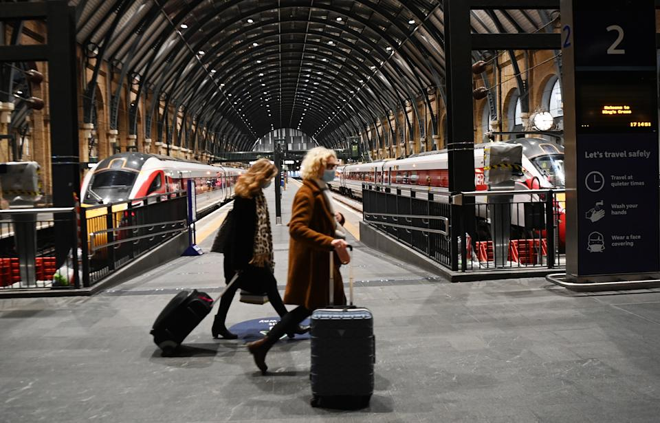 Commuters at Kings Cross train station in London, Britain.