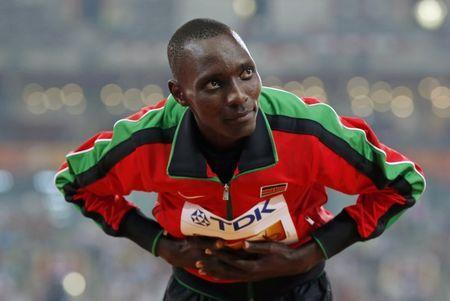 Asbel Kiprop of Kenya, gold medal, poses on the podium after the men's 1500m event during the 15th IAAF World Championships at the National Stadium in Beijing, China, August 30, 2015. REUTERS/Kim Kyung-Hoon