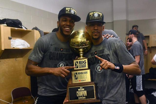 Jaron Blossomgame and Olivier Hanlan celebrate their recent G League championship with the Austin Spurs. (Getty Images)