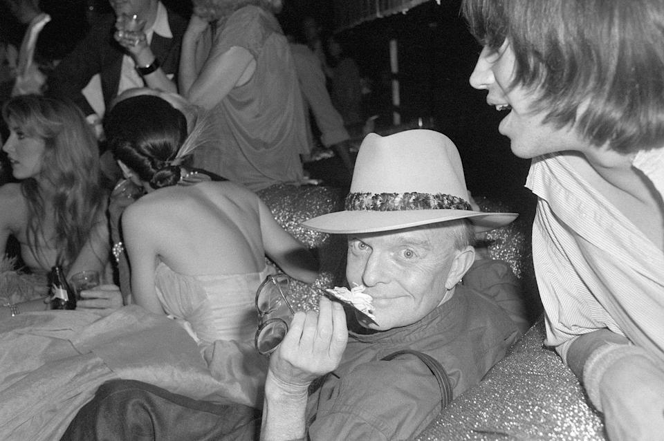 <p>Truman Capote attends a 10th anniversary party for Andy Warhol's Interview Magazine at Studio 54 in 1979.</p>