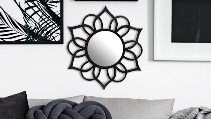 This decorative mirror has a flower-inspired silhouette.