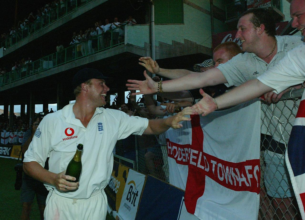 BRIDGETOWN, BARBADOS - APRIL 3:  Andrew Flintoff of England celebrates with fans after England won the third Cable and Wireless Test Match between West Indies and England at the Kensington Oval April 3 2004, in Bridgetown, Barbados.  (Photo by Ben Radford/Getty Images)