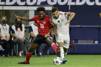 Trinidad and Tobago defender Triston Hodge (18) and Mexico forward Jesus Corona (17) vie for the ball during the first half of a CONCACAF Gold Cup Group A soccer match in Arlington, Texas, Saturday, July 10, 2021. (AP Photo/Michael Ainsworth)