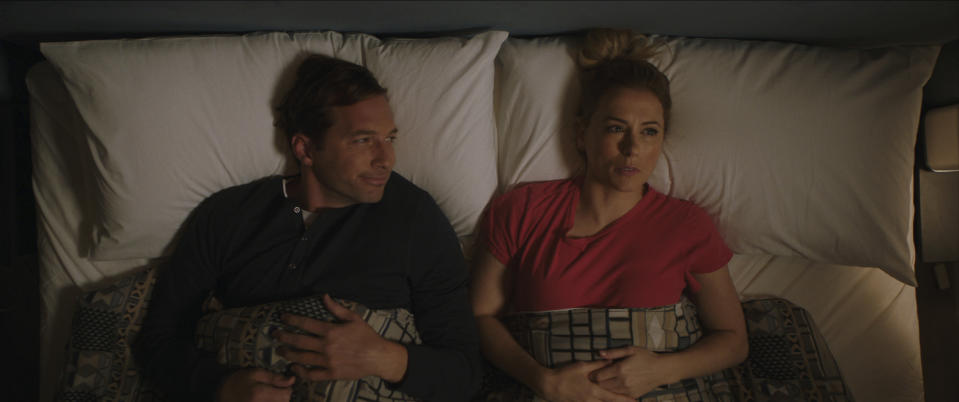 """This image released by Netflix shows Ryan Hansen, left, and Iliza Shlesinger in a scene from """"Good On Paper."""" (Netflix via AP)"""