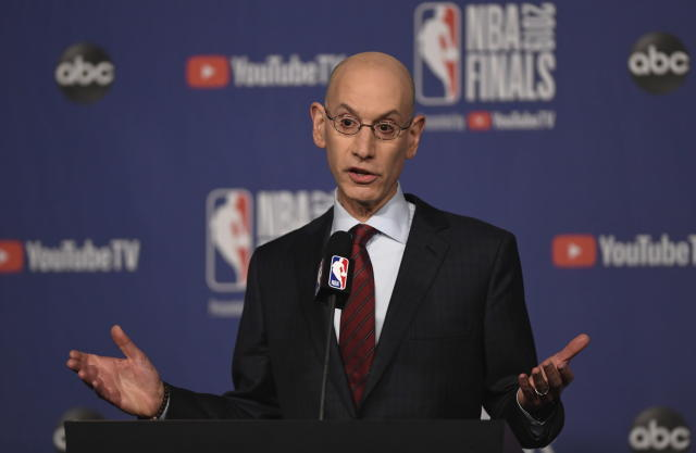 """FILE - In this May 30, 2019, file photo, NBA Commissioner Adam Silver holds a news conference before Game 1 of basketball's NBA Finals between the Golden State Warriors and the Toronto Raptors in Toronto. The NBA's board of governors was unanimous Friday, Sept. 20, 2019, in its approval of a plan to stiffen potential penalties for tampering with players and employees under contract with other clubs, hoping for increased compliance in existing league rules. """"We need to ensure that we're creating a culture of compliance in this league,"""" Silver said after two days of meetings concluded in New York. (Frank Gunn/The Canadian Press via AP, File)"""
