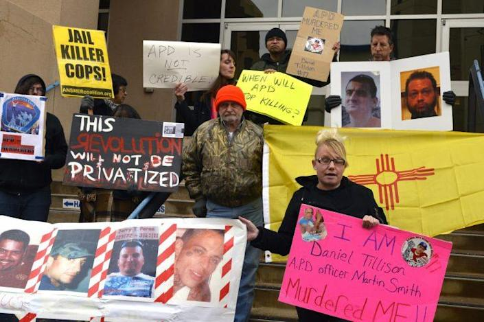 Demonstrators in front of Albuquerque police headquarters on January 14, 2015, protest a police shooting that left a suspect dead.