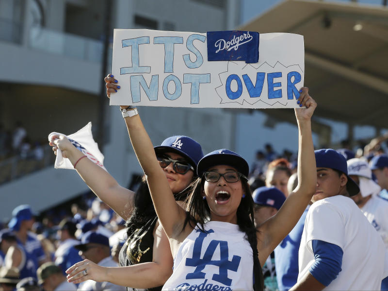 Los Angeles Dodgers fans cheer after Game 5 of the National League baseball championship series against the St. Louis Cardinals Wednesday, Oct. 16, 2013, in Los Angeles. The Dodgers won 6-4 and trail in the series 3-2. (AP Photo/Chris Carlson)